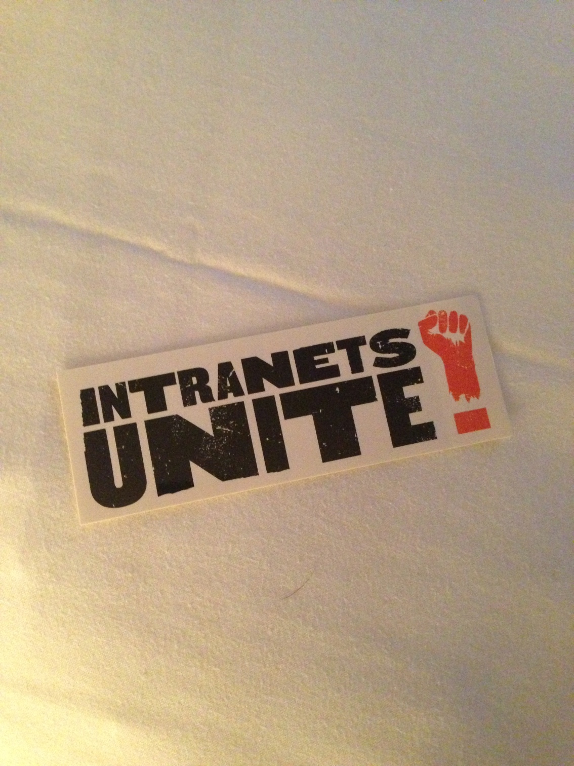 'Intranets Unite' sticker developed by StepTwo Designs for Intranets2013